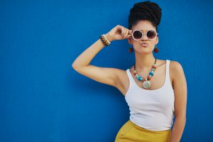Shot of an attractive young woman wearing funky sunglasses against a blue backgroundhttp://195.154.178.81/DATA/i_collage/pi/shoots/806374.jpg